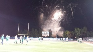 The dust settles on the field and pyro goes off in the end zone.