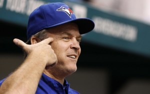 Aug 17, 2013; St. Petersburg, FL, USA; Toronto Blue Jays manager John Gibbons (5) gestures during the game against the Tampa Bay Rays at Tropicana Field. Mandatory Credit: Kim Klement-USA TODAY Sports